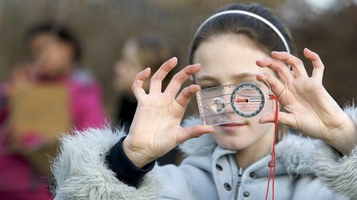 Pupil using a compass during fieldwork