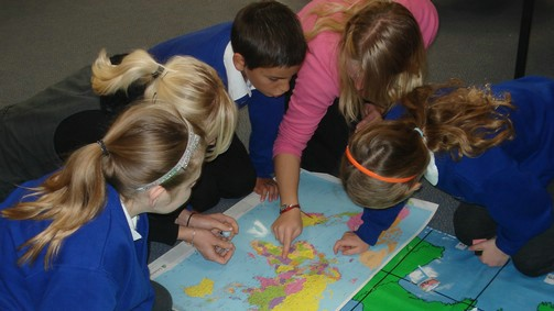 Pupils looking at a map