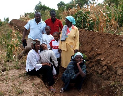 Mutisya family members show us a new terrace being constructed
