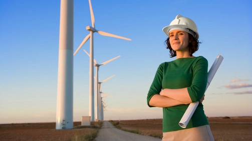 female engineer next to wind turbines