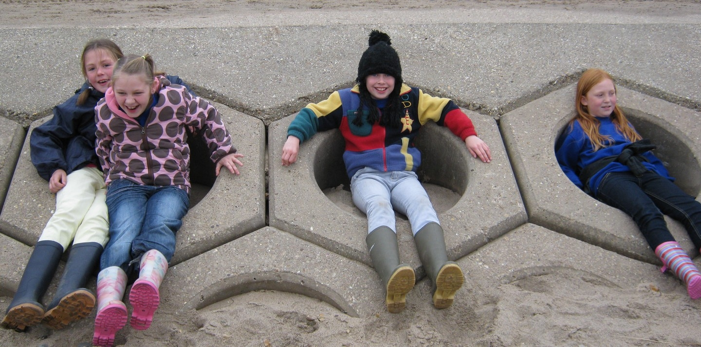 Students on sea defences